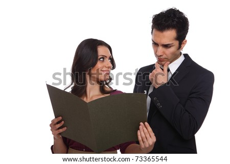 Secretary showing the boss the results and waiting for his opinion - stock photo