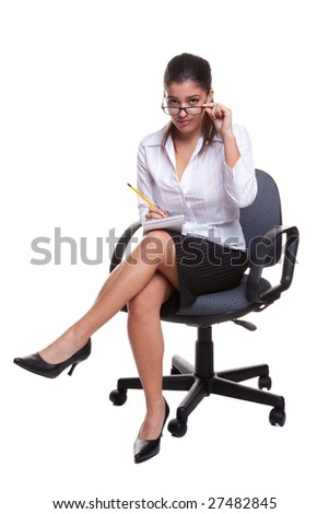 Secretary wearing glasses sitting on a swivel chair with notebook and pencil, isolated on white background - stock photo