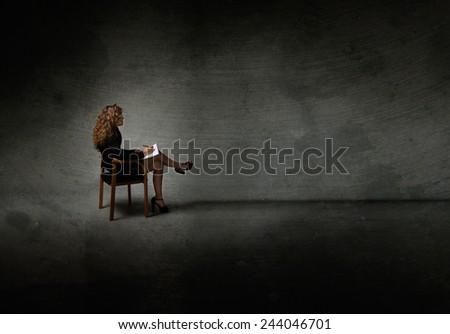 secretary with high heels posing in a dark room - stock photo
