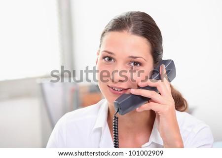 Secretary with telephone - stock photo
