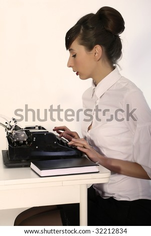 secretary working with vintage typewriter