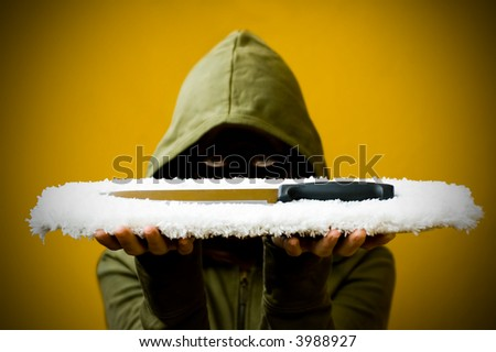 Secretly looking person presenting a knife - stock photo