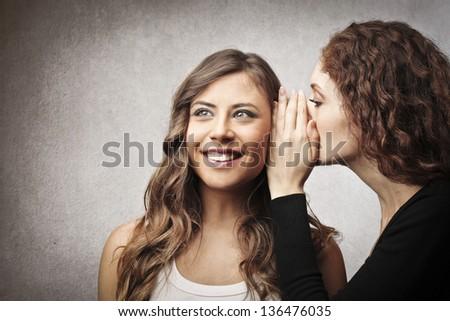 secrets between women - stock photo
