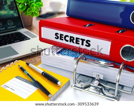 Secrets - Red Ring Binder on Office Desktop with Office Supplies and Modern Laptop. Business Concept on Blurred Background. Toned Illustration. - stock photo