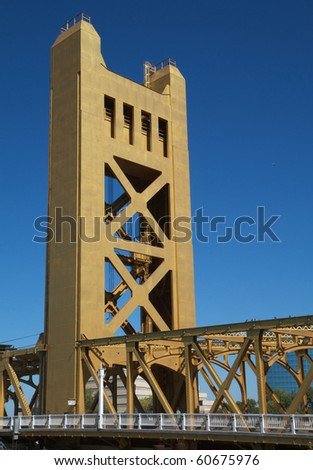 Section of a gold painted tower bridge in Sacramento - stock photo