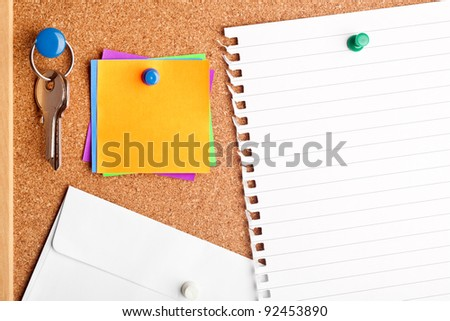 Section of a notice board filled with empty notes and paper - stock photo