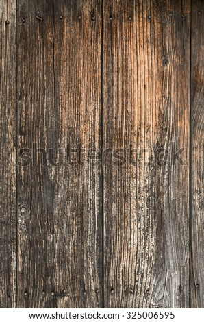 Section of an old door with wooden planks with rusty nails - stock photo