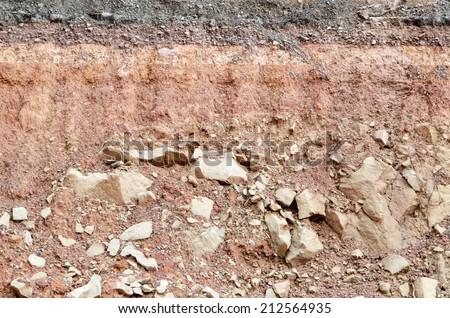 Section of asphalt road collapses.Layer of soil beneath section - stock photo