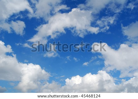 Section of blue sky with puffy clouds - stock photo