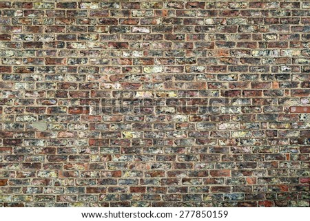 Section of brick wall of terraced house - stock photo