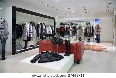 Section of female outer clothing in shop - stock photo