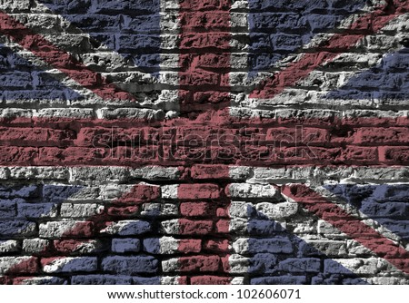 Section of old brick wall foverlaid with Union Jack flag - stock photo