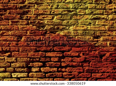 Section of old brick wall overlaid with colorful pattern - stock photo