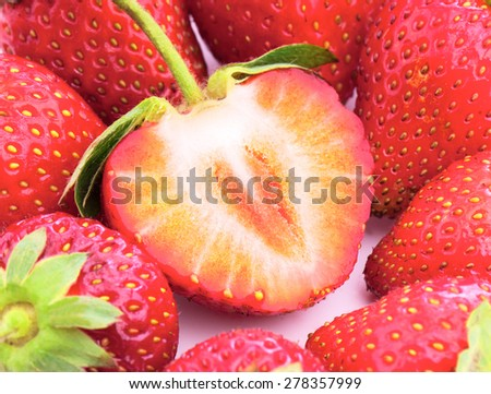 section of the ripe sugar strawberry which is grown up in own garden without pesticides - stock photo