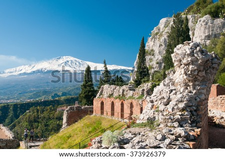 Section of the upper perimetral arcade of the greek theater of Taormina, Sicily, with snowy mount Etna in the background