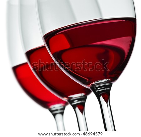 section of three wineglas with red wine isolated