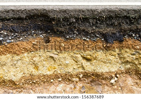 Section the road caused by water erosion of soil beneath the asphalt surface. - stock photo