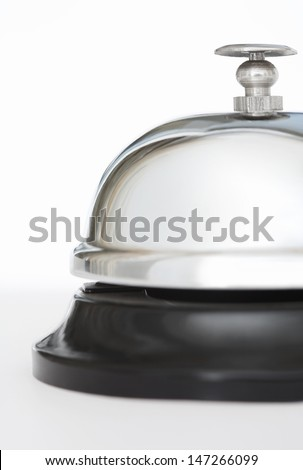 Section view of a luxury hotel silver reception bell against a plain white background, shining, glossy and expensive. - stock photo