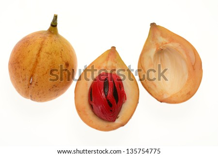 Sectional View Of A Ripe Nutmeg Fruit - stock photo