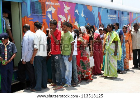 SECUNDERABAD,AP,INDIA-JUNE 05:Local people wait outside  Red Ribbon Express  to see the exhibits of the Indian Railways AIDS/HIV awareness campaign.  on June 05,2012 in Secunderabad,Ap,India.