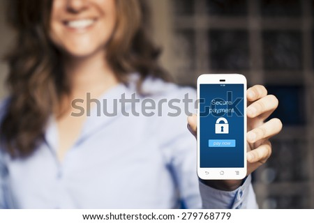 Secure payment message. Woman showing her mobile phone. - stock photo