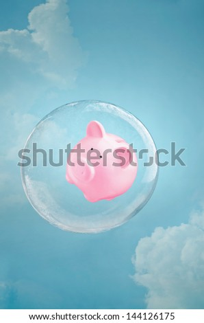 Secure savings. Piggy bank floating in a soap bubble in the sky - stock photo