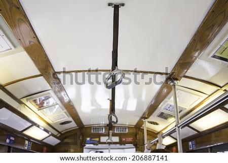 Securing indoor tram, public transport - stock photo