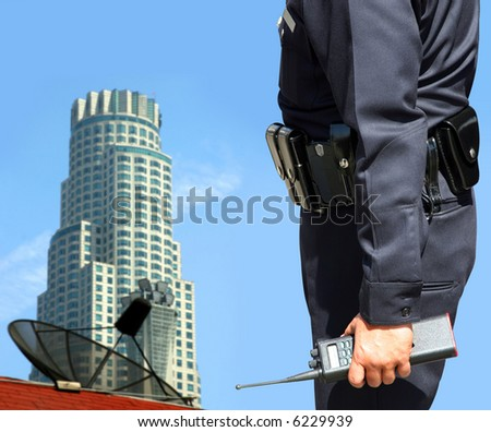 Security agent watching downtown area - stock photo