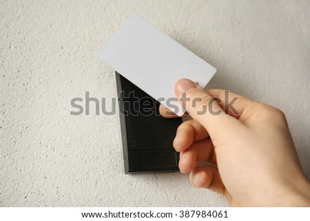 Security alarm with male hand on wall background, closeup - stock photo