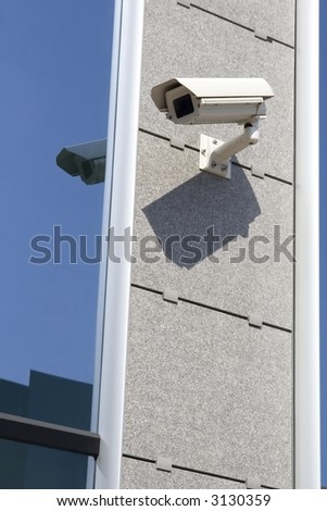 Security cam attached on building - stock photo
