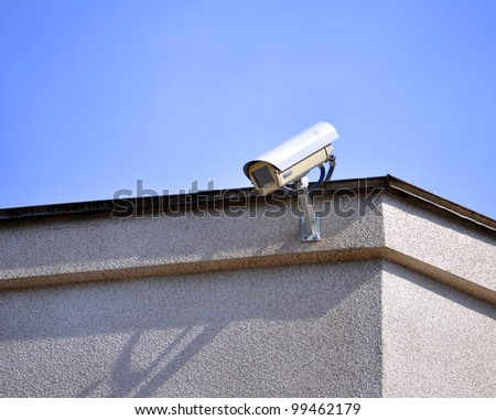 Security cam on the wall - stock photo