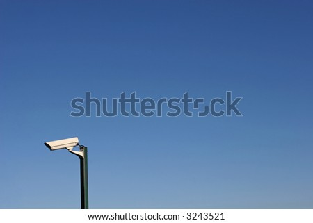 Security camera against the blue sky