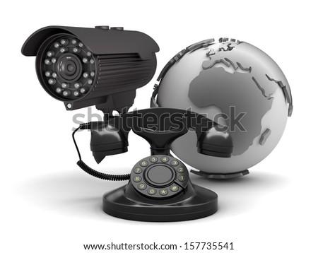 Security camera and retro rotary phone - stock photo