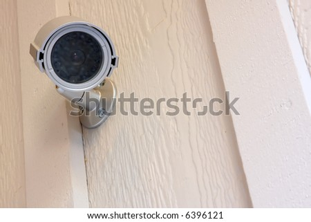 Security camera at the front entry of a residence.
