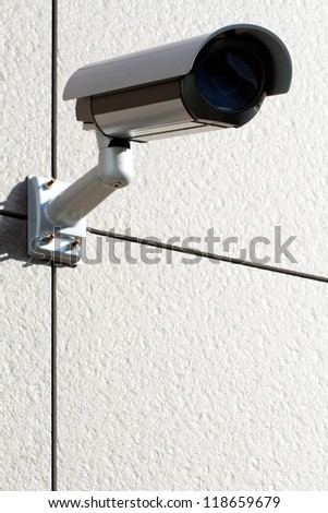 Security camera attached on the office building - stock photo