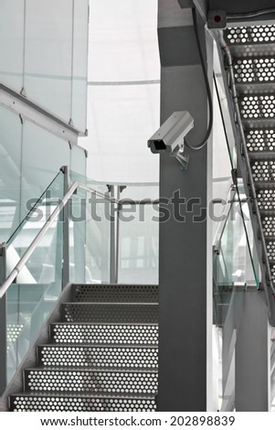 Security Camera CCTV on staircase location building - stock photo