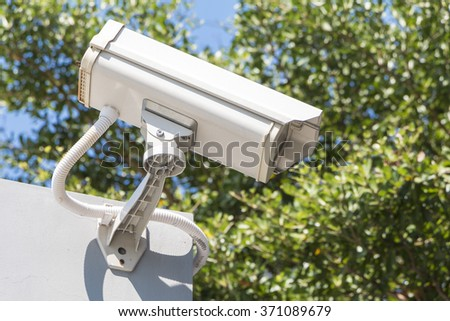 Security camera detects the movement watch right - stock photo