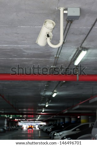Security camera in car park building - stock photo