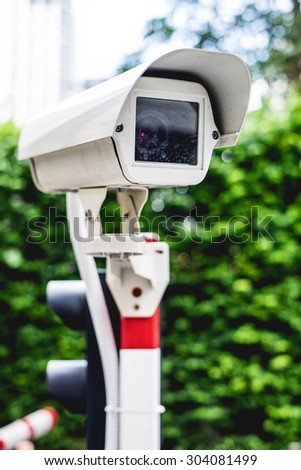Security Camera in Parking lot - stock photo