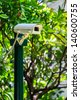 Security Camera in the Garden, CCTV Camera - stock photo