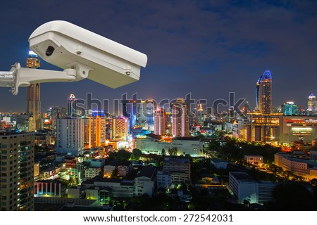 security camera monitor the movement of the top of the building - stock photo