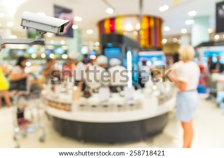 Security camera monitoring the store blur with bokeh background - stock photo