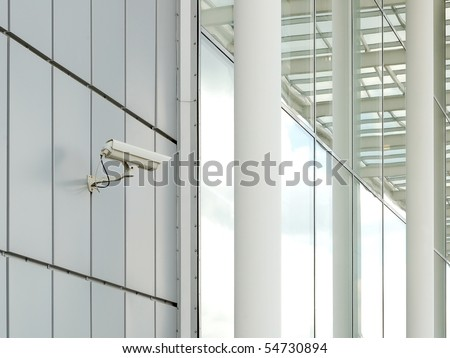 Security camera mounted on the facade of the modern building