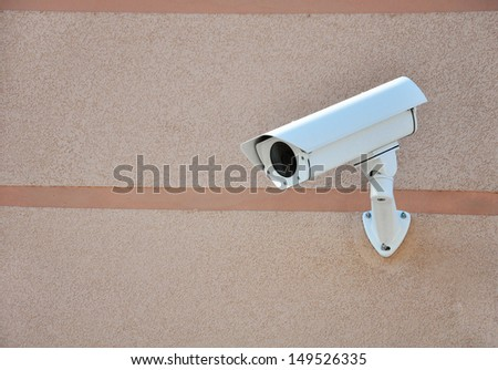 Security camera on modern building, technology concept - stock photo