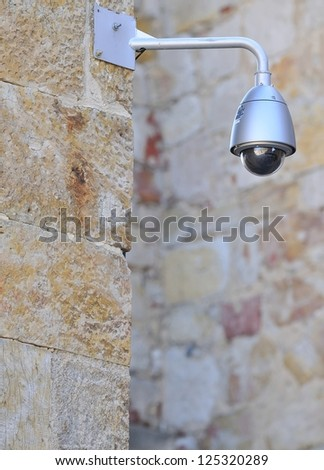 Security camera on street of a city. - stock photo