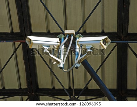 Security camera on the roof. - stock photo