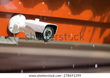 Security camera or CCTV in the rain - stock photo