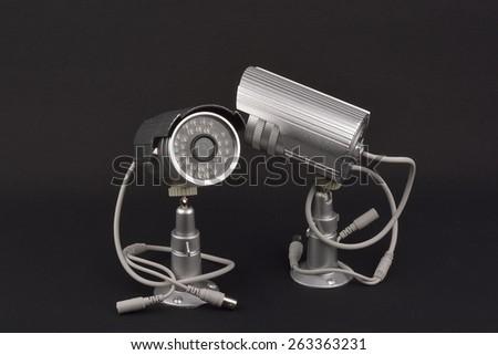 security camera. surveillance cameras - stock photo