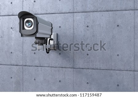 security camera watching to the left on concrete wall