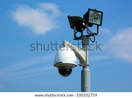 Security camera with light. - stock photo